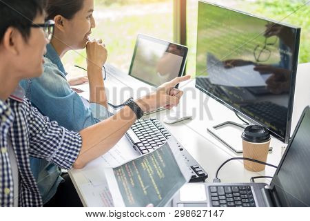 Asian Team Outsource Developer Looking Screen Programming Code Working With Laptop Computer Software