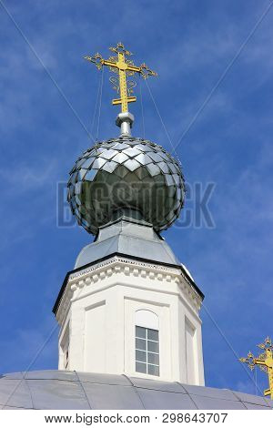 Gold Cross On The Dome Of The Temple Against The Blue Sky. Christianity, Orthodoxy, Religion.