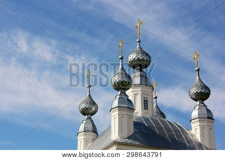 White Church With Five Domes With Golden Crosses And Blue Sky With Clouds. Empty Space For Your Text