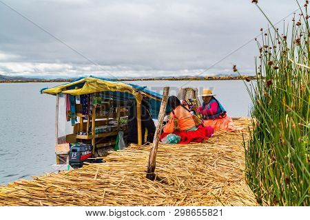 Puno, Peru - February 1, 2016 : Uru Woman Wearing Traditional Cloths Buying Food And Necessary Thing