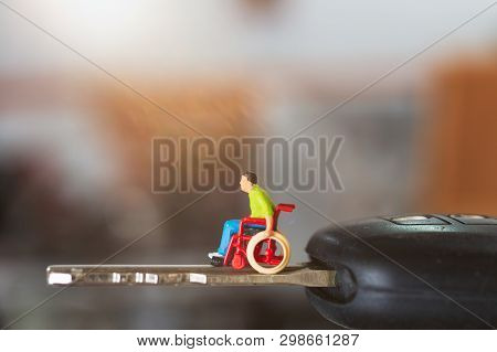 Miniature People : Disabled Man Sitting In Wheelchair  On Car Key