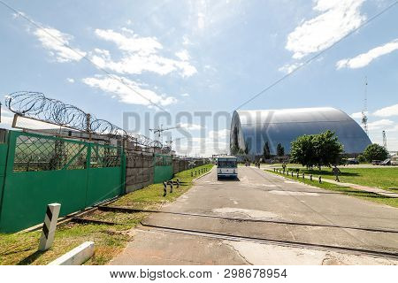 Chernobyl, Ukraine - June, 2016 : View Of The Destroyed Reactor 4 And The Memorial For The Chernobyl