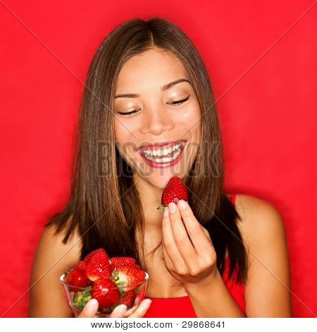 Strawberries - Woman Eating Strawberry