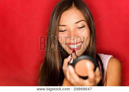 Woman Putting Makeup Lipstick