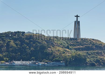 Catholic Monument Of Cristo Rei Or Christ The King. Viewed From A Distance Of Almada, Lisbon, Portug