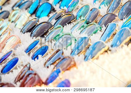 Colorful Variety Of Cheap Sunglasses Displayed On Market Stall For Sale