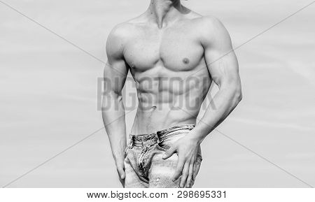 Sportsman muscular torso posing. Sport and bodycare. Muscular masculine guy look confident. Man sexy muscular bare torso stand outdoor blue sky background. Man muscular torso stand confidently poster