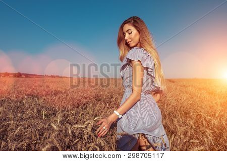 The Girl In A Dress, Walks In The Summer In Wheat Field. Happy Resting In Nature. Bright Sunny Day,