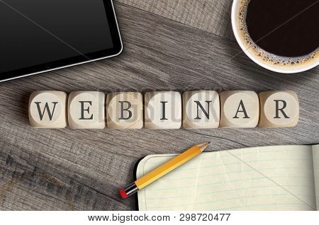 Cubes And Dice With Letters Webinar On A Workplace With Tablet And Pencil On Wooden Background