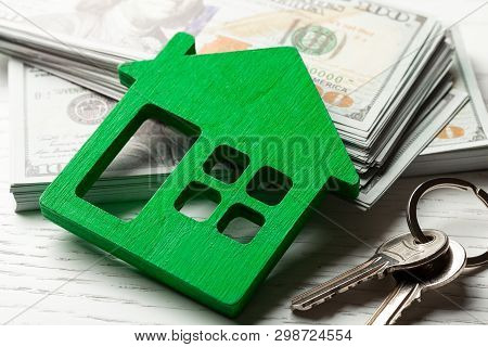 Wooden Hut With Money And Keys On A White Background. Buying Or Renting Or Selling. Concept Remont O