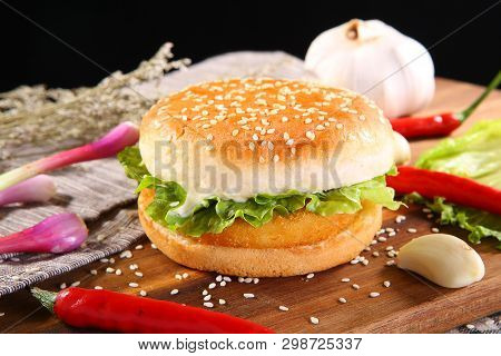 Rustic Chicken Burger On A Wooden Dish