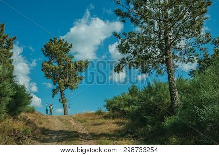 Serra Da Estrela, Portugal - July 14, 2018. People Waving In Dirt Road On A Hilly Terrain With Trees