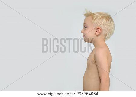 Surprised Smiling Blond Shirtless Boy. Profile. White Background
