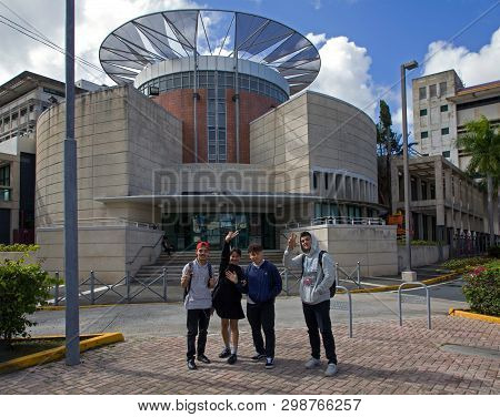 Bayamon/puerto Rico - February 26, 2019: Young Students Stand In Front Of Municipal Library