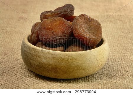 A Plate Of Sundried Apricots On Sackcloth