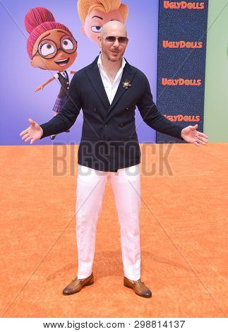 LOS ANGELES - APR 27:  Pitbull aka Armando Christian Perez arrives for the 'Ugly Dolls' World Premiere on April 27, 2019 in Los Angeles, CA