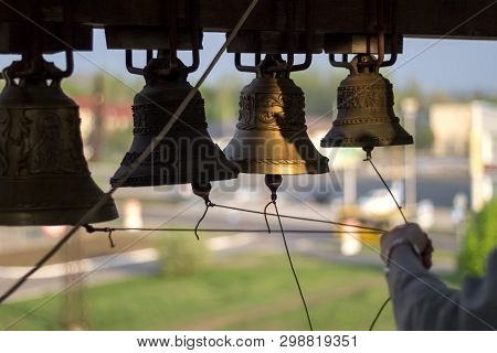 Church Chimes And Knot Of Ropes In Hand Of Bell-ringer On Belfry Of Trinity Cathedral, During Bells