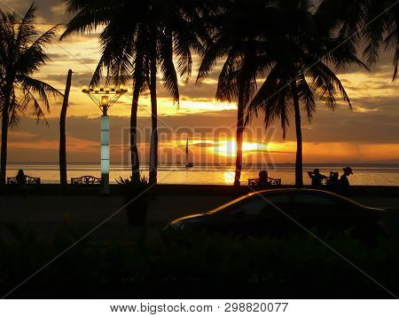 Romantic Sunset On A Tropical Beach With Palms