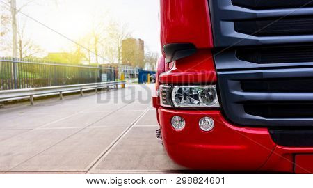 Close Up Of A Red Semi Truck . The Red Truck In A Warehouse . Truck Logistics Building . The Red Tru