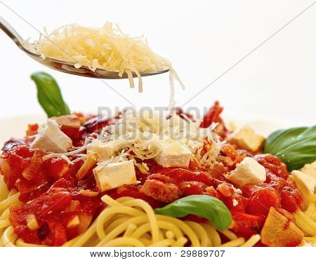 Spaghetti Bolognese with Parmesan cheese on the spoon