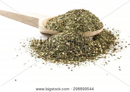 Green Savory Mix Or Chubritsa On Wooden Spoon On White Background