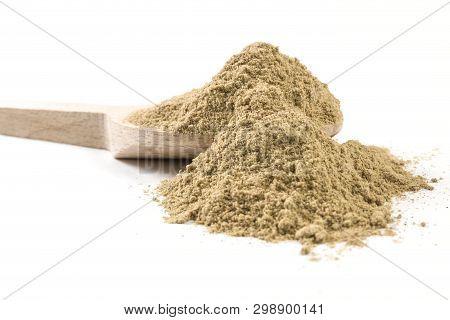Cardamon Powder On Wooden Spoon On White Background