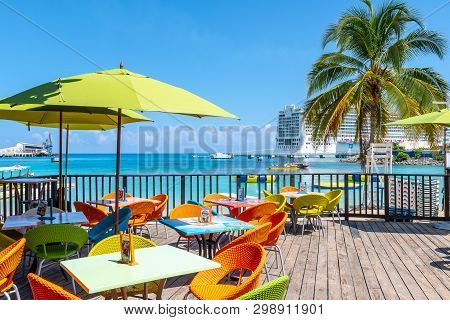 Ocho Rios, Jamaica - April 23 2019: Tropical Island Caribbean Color Chairs & Tables At Margaritavill
