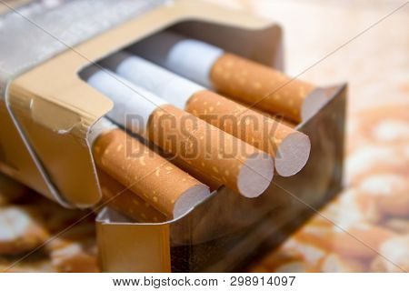 Cigarettes In A Pack. Yellow Filter. Harm To Health. Bad Habit. A Pack Of Cigarettes On The Table. O