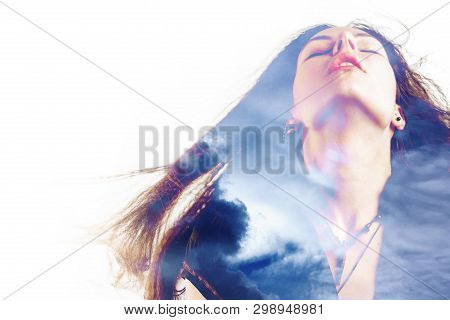 Portrait Of A Young Attractive Woman And Clouds In The Sky, Double Exposure. Dreams And Soul, Mental