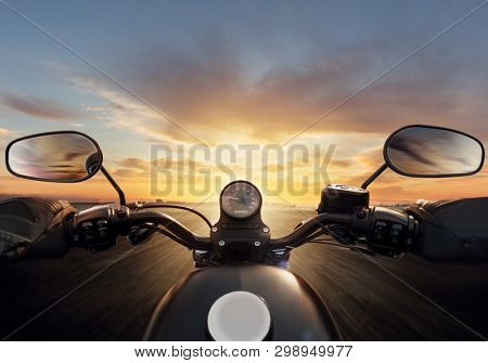 POV of motorcycle driver with handlebars. Outdoor photography. Travel and sport, speed and freedom concept