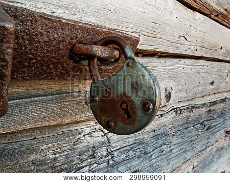 An Old Lock Hangs On A Wooden Door At The Old Town Of Kalajoki, Finland. The Old Fishing Village Has