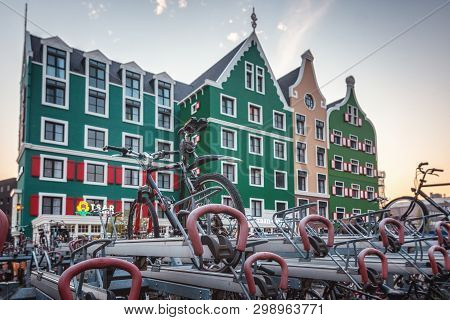 Zaandam, The Netherlands, April 18, 2019: Bicycle Parking At Zaandam Station With In The Background