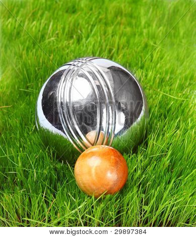 The bocce balls on a green grass. Close up with shallow dof.