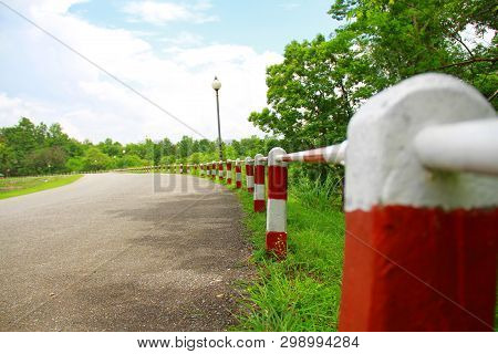 Red And White Milestone Are Long Line And Indicative The Way To Success Or Goal.