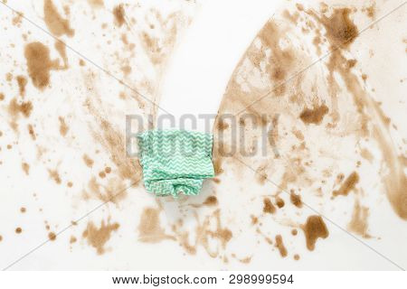 Green Cloth Or Rag Wiping Clean A Dirty Counter Top Or Floor