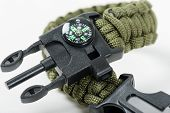 closeup green multifunction paracord survival bracelet for camping poster