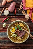Malaysia Spicy Noodle Mee Rebus With Beef Egg and fried onion, copy space poster