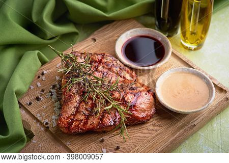 Grilled Florentine Steak On A Chopping Board. Cooked Beef Meat. White Wooden Background.