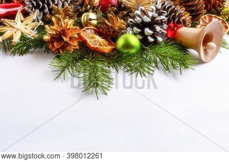 Christmas Decoration With Spruce Branches And Golden Pine Cones