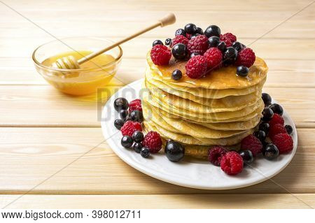 Pet Pancakes With Honey And Fresh Berries. Stack Of Breakfast Pancakes Served With Blueberry, Raspbe