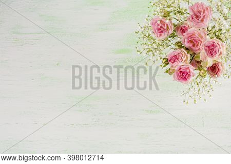 Pink Roses On Light Green Background. Flowers  Greeting Card With Place For Text.