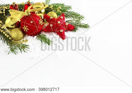 Red And Golden Vintage Christmas Ornaments In Snow. Christmas Decoration On The White Background. Co