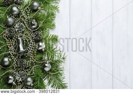 Vintage Christmas Background With Silver Ornaments, Copy Space. Christmas Decoration With Fir Branch