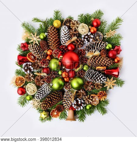 Vivid Christmas Wreath With Fir Branches, Pine Cones And Rustic Ornaments. Christmas Decoration With