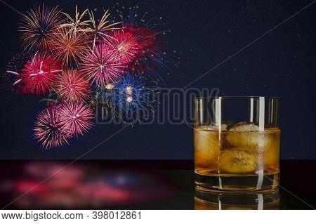 Whiskey Of Ice And Celebration Fireworks. Amazing Fireworks Over Night Sky. Beautiful Fireworks. 4 O