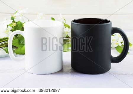 White And Black Mug Mockup With Spring Apple Blossom. Coffee Cup Mockup. Empty Mug Mockup For Produc
