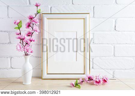 White Frame Mockup With Pink Spring Flower Bunch. Empty White Frame Mockup For Design Presentation.