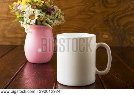 White Coffee Mug Mockup With Field Flowers. Empty Mug Mockup For Product Presentation. Coffee Cup Mo
