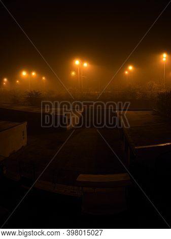 Chomutov, Czech Republic - November 07, 2020: Lamps In Foggy Night - Analog Noise 400 Asa Texture