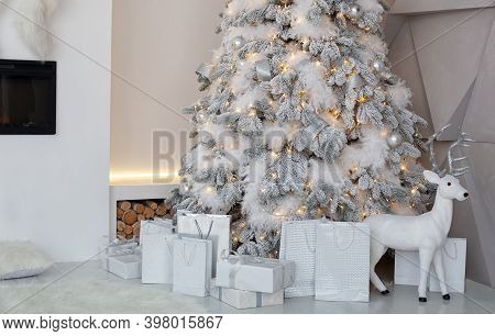Christmas Interior Of Living Room With Decorated Christmas Tree, Fireplace With Christmas Socks. Chr